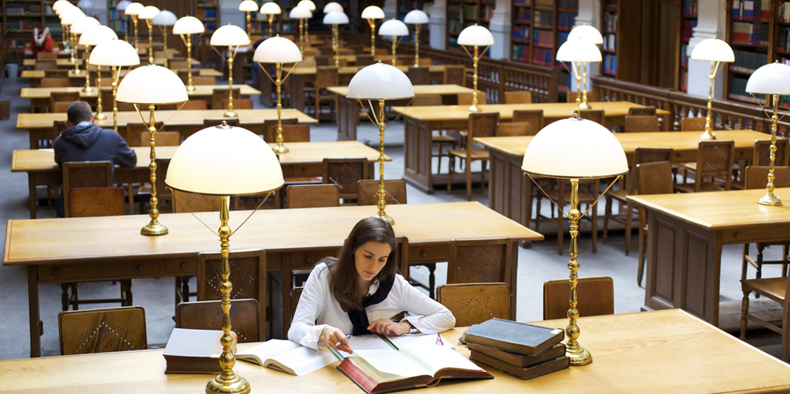 photo of a young female student studying in library